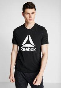 Reebok - WORKOUT READY - Camiseta de deporte - black - 0
