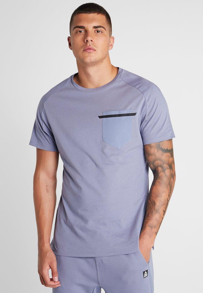 Reebok - MOVE TEE - T-shirts print - wasind