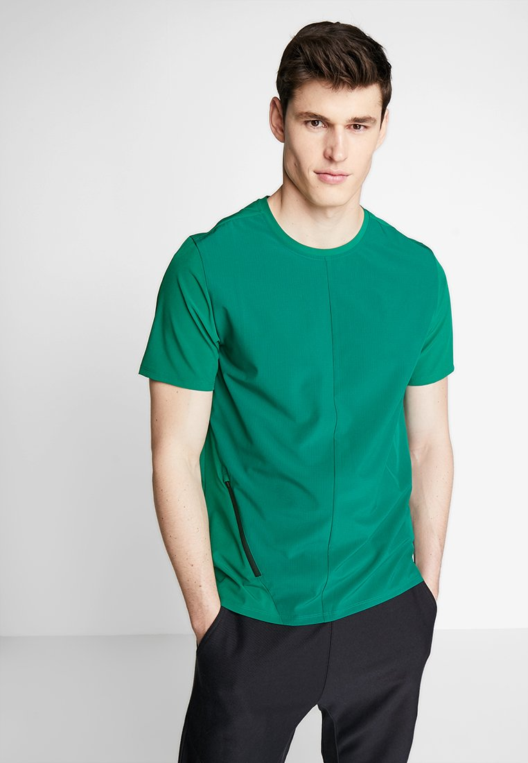 Reebok - WOVEN TEE - T-shirt basic - green