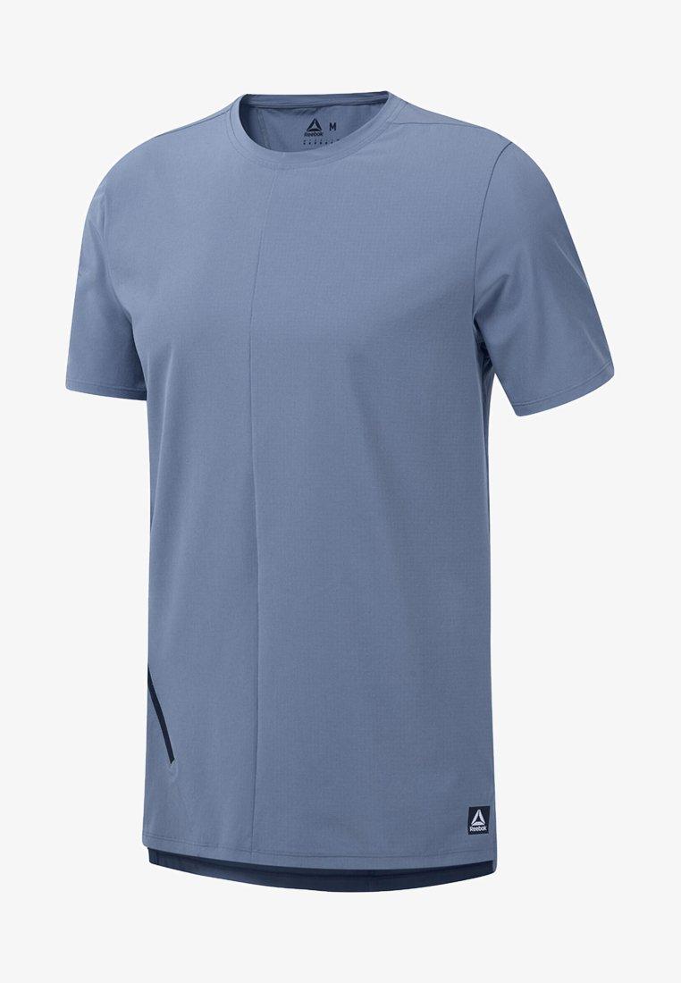 Reebok - TRAINING SUPPLY WOVEN TEE - T-shirt med print - blue