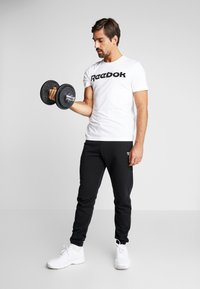 Reebok - ELEMENTS SPORT SHORT SLEEVE GRAPHIC TEE - T-shirt print - white - 1