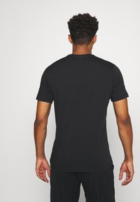 Reebok - STACKED TEE - T-shirt print - black - 2