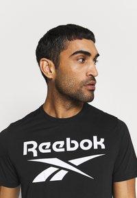 Reebok - SPEEDWICK SPORT SHORT SLEEVE GRAPHIC TEE - Camiseta estampada - black - 3