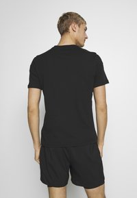 Reebok - LOGO TEE - T-shirt imprimé - black - 2