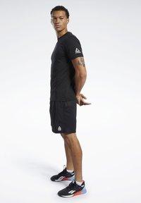Reebok - REEBOK CROSSFITMESS YOU UP TEE - T-Shirt print - black - 1