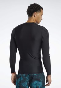 Reebok - GRAPHIC COMPRESSION TEE - Long sleeved top - black - 2