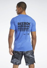 Reebok - SPEEDWICK MOVE TEE - Print T-shirt - blue - 2