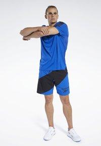 Reebok - WORKOUT READY TECH TEE - Print T-shirt - blue - 1