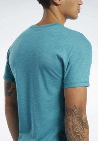 Reebok - REEBOK  MOVE TEE - T-shirts print - teal - 5