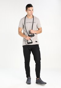 Reebok - TRAINING TRACK PANTS - Pantalones deportivos - black - 1