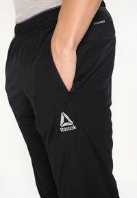 Reebok - TRAINING TRACK PANTS - Pantalones deportivos - black - 4