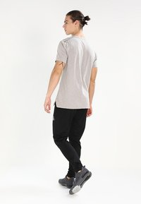 Reebok - TRAINING TRACK PANTS - Pantalones deportivos - black - 2