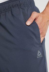 Reebok - TRAINING ESSENTIALS - Pantalon de survêtement - dark blue - 4
