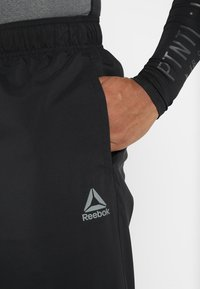 Reebok - TRAINING ESSENTIALS - Träningsbyxor - black - 3