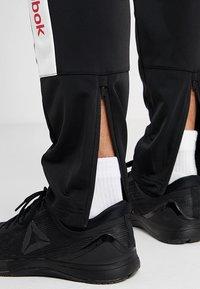 Reebok - TRAINING ESSENTIALS TRACK PANTS - Tracksuit bottoms - black - 3