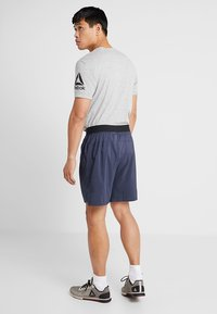 Reebok - OST EPIC GRAPHIC - Sports shorts - dark blue - 2