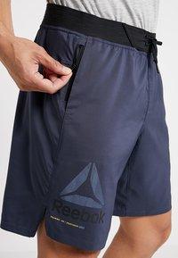 Reebok - OST EPIC GRAPHIC - Sports shorts - dark blue - 4