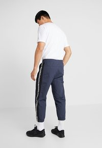 Reebok - MEET YOU THERE TRAINING 7/8 JOGGER PANTS - Tracksuit bottoms - navy - 2