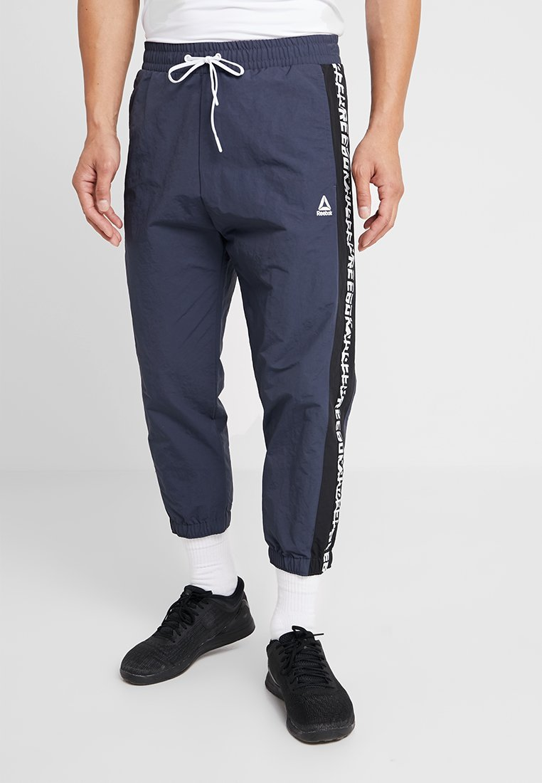 Reebok - MEET YOU THERE TRAINING 7/8 JOGGER PANTS - Tracksuit bottoms - navy