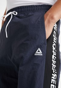 Reebok - MEET YOU THERE TRAINING 7/8 JOGGER PANTS - Tracksuit bottoms - navy - 5