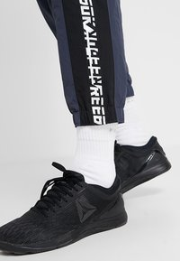 Reebok - MEET YOU THERE TRAINING 7/8 JOGGER PANTS - Tracksuit bottoms - navy - 3