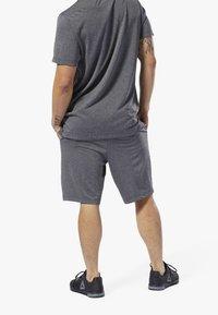 Reebok - WOR KNIT PERFORMANCE SHORTS - Shorts - black - 2
