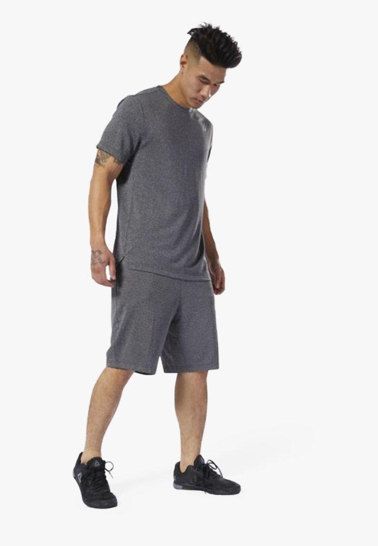 Reebok - WOR KNIT PERFORMANCE SHORTS - Shorts - black