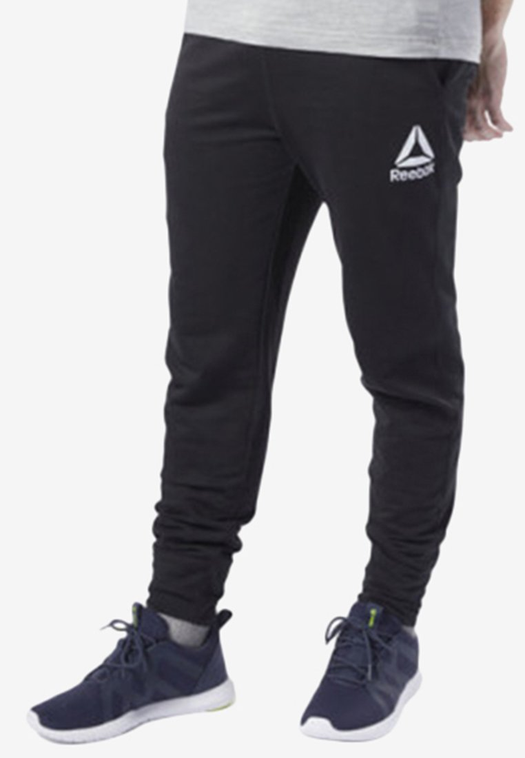 Reebok - TRAINING ESSENTIALS LOGO JOGGER PANTS - Tracksuit bottoms - black
