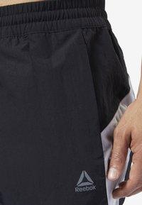 Reebok - ONE SERIES TRAINING COLORBLOCK PANTS - Verryttelyhousut - black - 4
