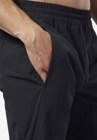 Reebok - ONE SERIES TRAINING COLORBLOCK PANTS - Verryttelyhousut - black - 5
