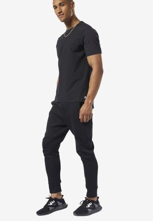 TRAINING SUPPLY KNIT JOGGER PANTS - Kangashousut - black