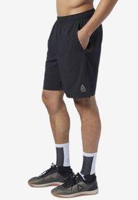 Reebok - REEBOK GAMES AUSTIN II SHORTS - Sports shorts - black - 0