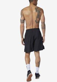 Reebok - REEBOK GAMES AUSTIN II SHORTS - Sports shorts - black - 1
