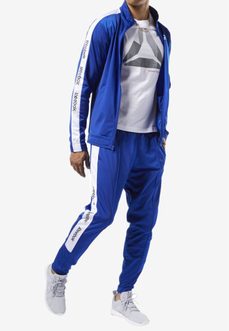 Reebok - TRAINING ESSENTIALS LOGO TRACKSTER PANTS - Jogginghose - blue