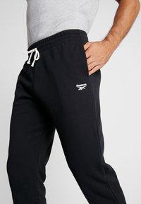 Reebok - CUFFED PANT - Pantalon de survêtement - black - 4