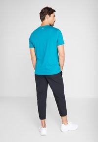 Reebok - 7/8 PANT - Pantalones deportivos - black - 2