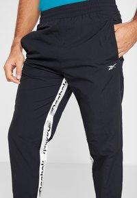 Reebok - 7/8 PANT - Pantalones deportivos - black - 4