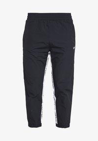 Reebok - 7/8 PANT - Pantalones deportivos - black - 3