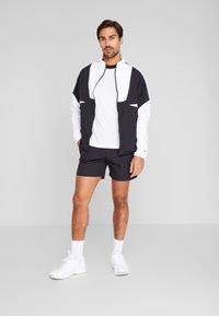 Reebok - Pantalón corto de deporte - black - 1