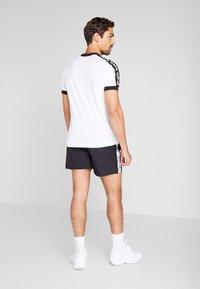 Reebok - Pantalón corto de deporte - black - 2