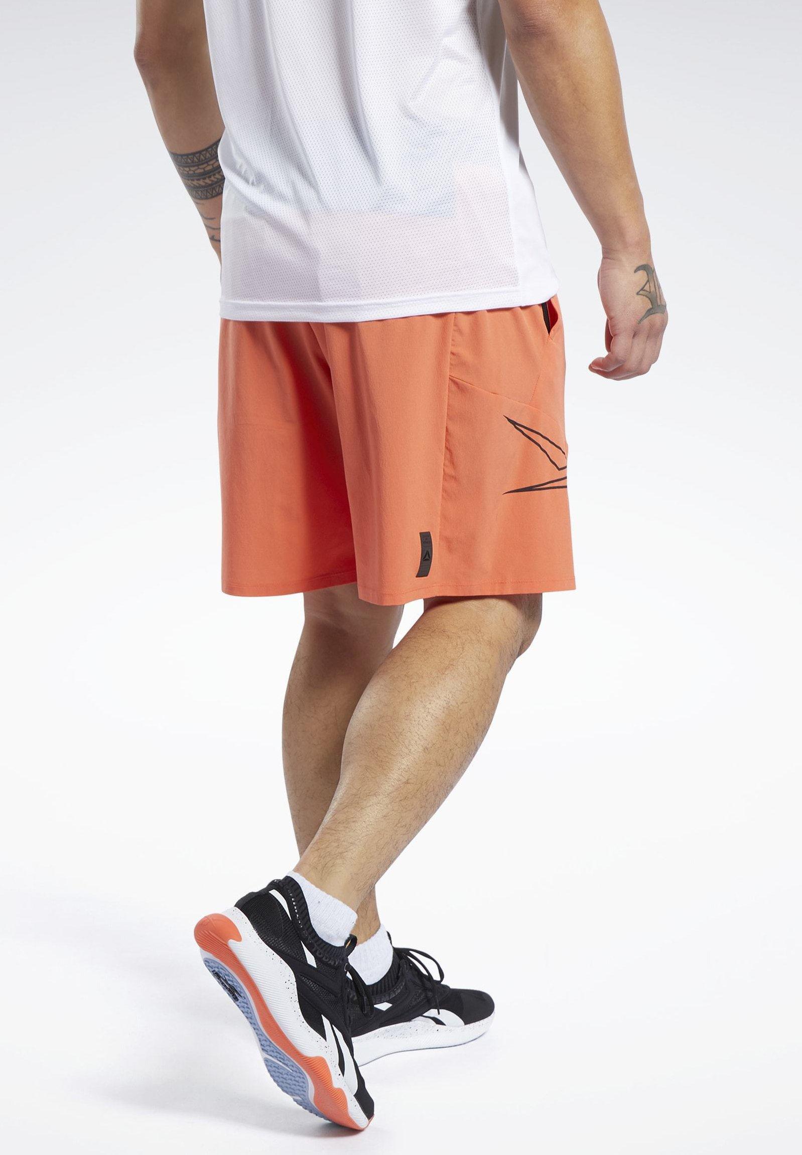 Reebok UNITED BY FITNESS EPIC SHORTS - Krótkie spodenki sportowe - vivid orange