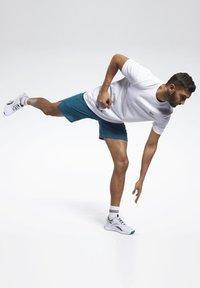 Reebok - EPIC SHORTS - Sports shorts - heritage teal - 1