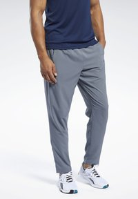 Reebok - WORKOUT READY TRACKSTER PANTS - Tracksuit bottoms - grey - 0
