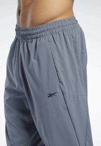 Reebok - WORKOUT READY TRACKSTER PANTS - Tracksuit bottoms - grey - 4