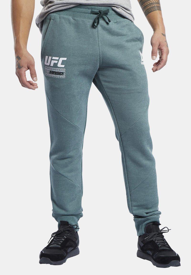 Reebok - UFC FG FIGHT WEEK JOGGERS - Pantalon de survêtement - ivy green