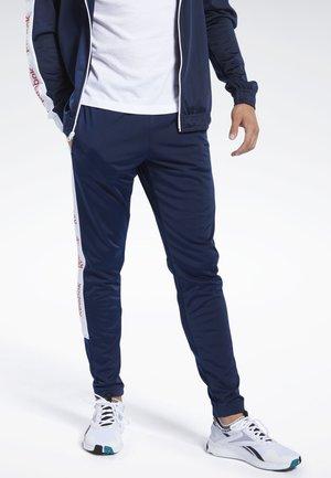 TRAINING ESSENTIALS TRACKSTER PANTS - Pantalon de survêtement - blue