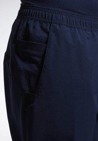 Reebok - 2020-01-01 UNITED BY FITNESS TRACKSTER PANTS - Spodnie treningowe - blue - 5