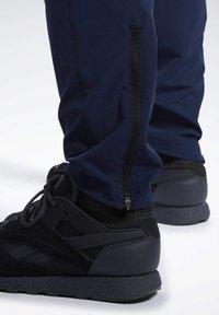 Reebok - 2020-01-01 UNITED BY FITNESS TRACKSTER PANTS - Spodnie treningowe - blue - 4