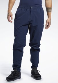 Reebok - 2020-01-01 UNITED BY FITNESS TRACKSTER PANTS - Spodnie treningowe - blue - 0