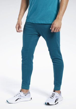 TRAINING ESSENTIALS LINEAR LOGO JOGGERS - Tracksuit bottoms - heritage teal